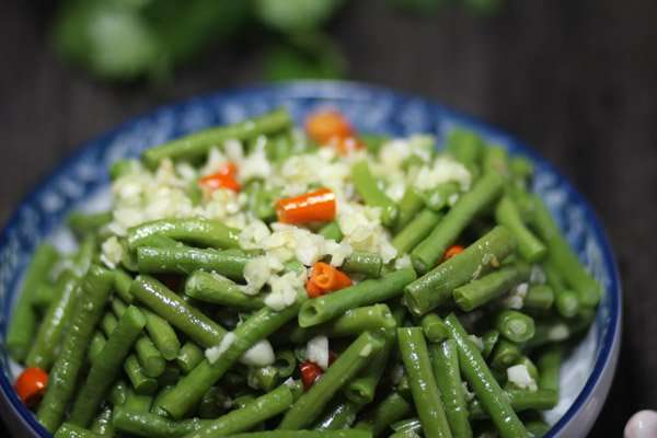 Green cowpea salad, with red chili , chopped garlic on a plate