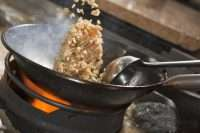 stir-frying rice with pan tossing cooking way