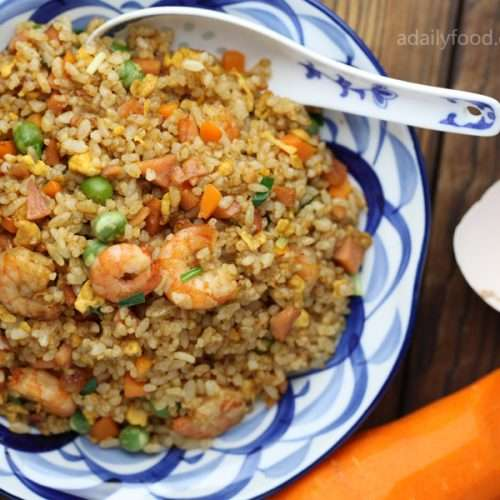 Chinese stir fried rice in a plate with a spoon