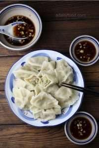 celery dumplings in a plate, sauce