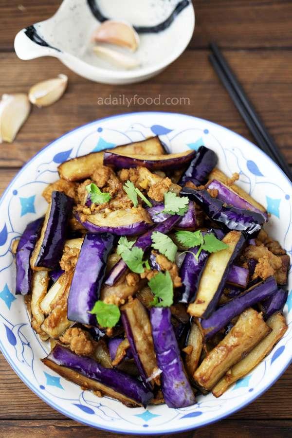 eggplant and chopped pork stir fry, garlic , chopsticks