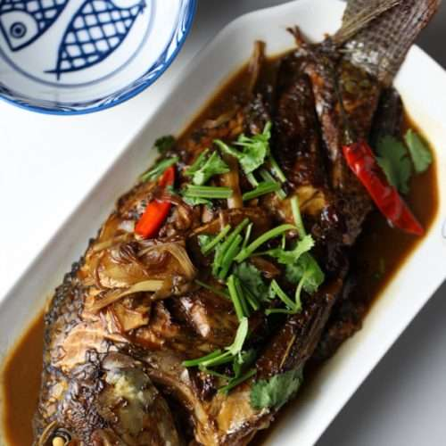 Chinese red-cooked fish,garnish with red chili