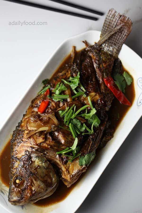 The Chinese red-cooked fish in a white plate